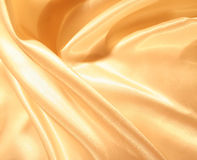 Smooth elegant gold satin as background Royalty Free Stock Image