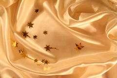 Smooth elegant gold satin background Stock Images