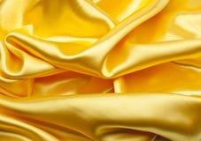 Smooth elegant golden satin Stock Photography