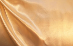 Smooth elegant golden silk as background Royalty Free Stock Image