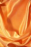 Smooth elegant golden silk as background Royalty Free Stock Photos