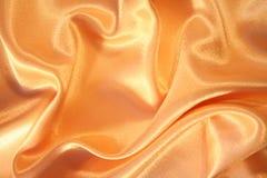 Smooth elegant golden silk as background Stock Photos