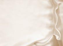 Smooth elegant golden silk as wedding background. In Sepia toned Stock Photo