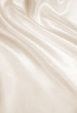 Smooth elegant golden silk as wedding background. In Sepia toned Stock Photography