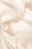 Smooth elegant golden silk as wedding background. In Sepia toned Royalty Free Stock Photo