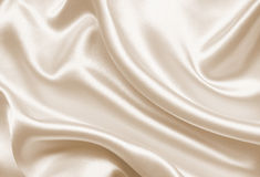 Smooth elegant golden silk as wedding background. In Sepia toned Royalty Free Stock Images