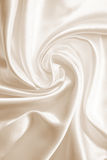 Smooth elegant golden silk as wedding background. In Sepia toned Stock Image