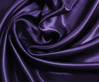 Smooth elegant golden silk or satin as background. In Sepia tone Royalty Free Stock Photos