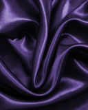 Smooth elegant golden silk or satin as background. In Sepia tone Royalty Free Stock Image