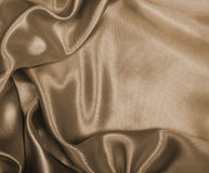 Smooth elegant golden silk or satin as wedding background. In Se Royalty Free Stock Images