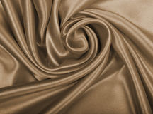 Smooth elegant golden silk or satin as wedding background. In Se Stock Photos