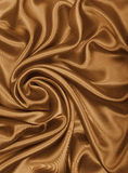 Smooth elegant golden silk or satin texture as abstract backgrou. Smooth elegant golden silk or satin texture can use as abstract background. Luxurious Royalty Free Stock Photos