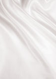 Smooth elegant golden silk or satin texture as background. In Se Royalty Free Stock Photos