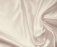 Smooth elegant golden silk or satin texture as background. In Se Stock Image