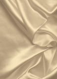 Smooth elegant golden silk or satin texture as background. In Se Stock Photography