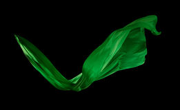 Smooth elegant green cloth on black background Stock Photography