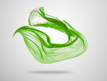Smooth elegant green cloth on grey background Stock Images