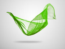 Smooth elegant green cloth on grey background Royalty Free Stock Images