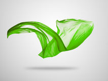 Smooth elegant green cloth on grey background Royalty Free Stock Image