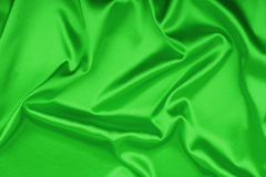 Smooth elegant green silk background Royalty Free Stock Image