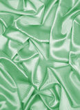 Smooth elegant green silk or satin as background Royalty Free Stock Photography