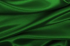 Smooth elegant green silk or satin luxury cloth texture as abstract background. Luxurious background design royalty free stock photo