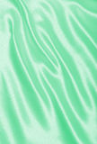 Smooth elegant green silk or satin texture as background Royalty Free Stock Photos