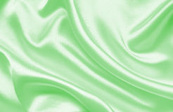 Smooth elegant green silk or satin texture as background Stock Image
