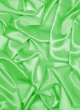 Smooth elegant green silk or satin texture as background Stock Images