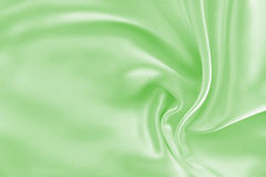 Smooth elegant green silk or satin texture as background Royalty Free Stock Photography