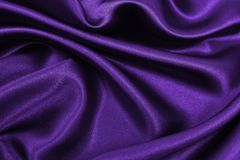 Smooth elegant lilac silk or satin luxury cloth texture as abstract background. Luxurious background design. Smooth elegant lilac silk or satin luxury cloth royalty free stock photography