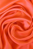 Smooth elegant orange silk as background Stock Images