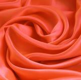 Smooth elegant orange silk or satin as background Stock Photography