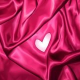 Smooth elegant pink silk with heart. Vector Stock Images