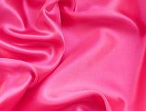 Smooth elegant pink silk or satin as background Stock Image