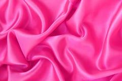 Smooth elegant pink silk or satin as background Stock Photo