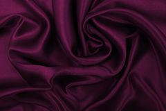 Smooth elegant pink silk or satin luxury cloth texture as abstract background. Luxurious background design. Smooth elegant pink silk or satin luxury cloth royalty free stock photo