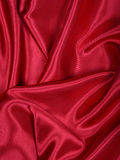 Smooth elegant red silk as background Stock Images