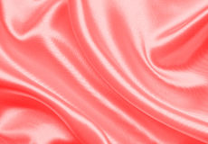Smooth elegant red silk or satin as background Stock Image