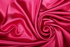 Smooth elegant red silk or satin texture as background Stock Image