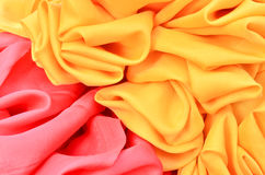 Smooth elegant red and yellow satin Stock Image