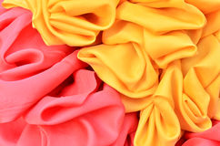 Smooth elegant red and yellow satin Stock Photos