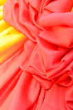 Smooth elegant red and yellow satin Stock Photography