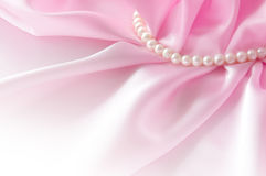 Smooth elegant rose silk background with pearl, Beautiful silk drapes Royalty Free Stock Image