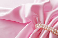 Smooth elegant rose silk background with pearl, Beautiful silk drapes Stock Photos