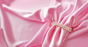 Smooth elegant rose silk background with pearl, Beautiful silk drapes Stock Photo