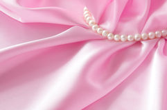 Smooth elegant rose silk background with pearl, Beautiful silk drapes Stock Photography