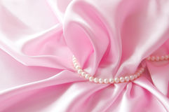 Smooth elegant rose silk background with pearl, Beautiful silk drapes Stock Images