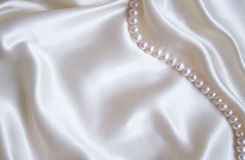 Smooth elegant white silk with pearls Stock Photos