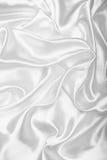 Smooth elegant white silk or satin as wedding background Stock Images